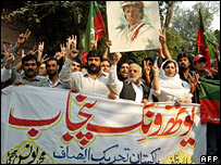 Supporters of Mr Khan's party holding a rally on 4 November 2007