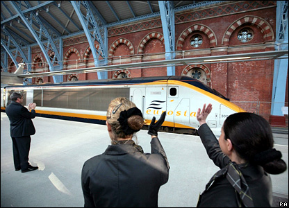 Staff wave off the first high speed train from St Pancras to Paris