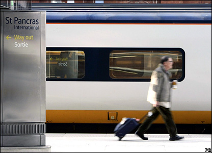 A passenger boards the first high-speed Eurostar train to leave St Pancras