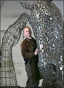 Scupltor Andy Scott with his creations