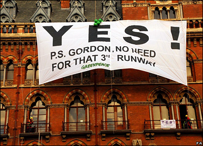 "Greenpeace climbers display a banner emblazoned with the word ""YES!"" to show their support of the new rail link, after scaling the front of St Pancras station in London"