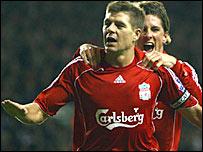 Steven Gerrard celebrates a Liverpool goal with Fernando Torres