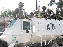 African Union peacekeepers from Uganda patrol on an armoured vehicle in Mogadishu
