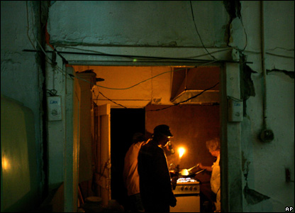 With the electricity down, residents of Maria Elena, Chile, are forced to use a torch, 14 Nov 2007