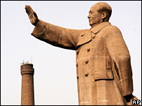 Chairman Mao statue and chimney. Image: AP