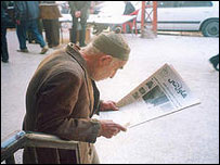 Iraqi Kurdish man reading newspaper