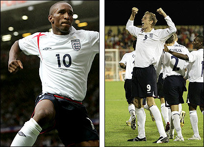 Jermain Defoe (left) and Peter Crouch celebrate getting England's campaign off to a flier