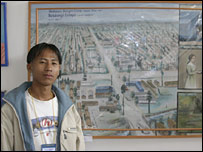 Amit Subba with his picture of the refugee camp
