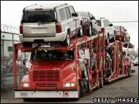 A transporter carries DaimlerChrysler vehicles in Detroit, Michigan