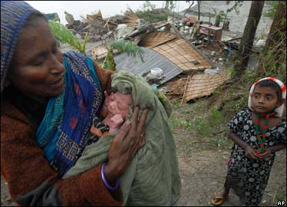 A grandmother holds a newborn bay in Barisal, 16 November 2007