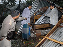 Local residents look inside a damaged class room at a school in Bangladesh 16/11/07