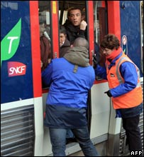 SNCF employees close a regional train's doors at Gare Saint-Lazare station, Paris, 16/11