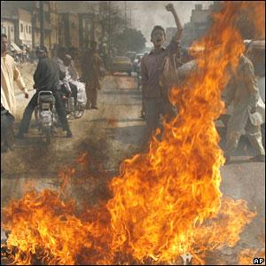 An effigy of General Pervez Musharraf is burned in Karachi, Pakistan
