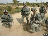 US soldiers with the 101st Airborne Division and Iraqi soldiers patrol the village of al-Awsat south of Baghdad