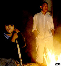 Roma boys by campfire