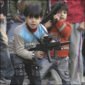 Palestinian children play with toy guns in the West Bank city of Nablus