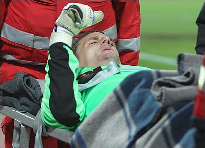 Austria keeper Jurgen Macho is stretchered off after colliding with Peter Crouch