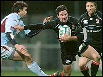 Rudolf Coetzee of Bourgoin tries to stop Ulster's Paddy Wallace