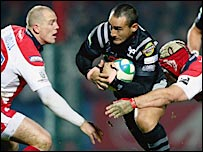 Ospreys centre Sonny Parker takes on the Gloucester defence