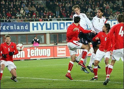 Peter Crouch rises above Austria's defence to head England ahead
