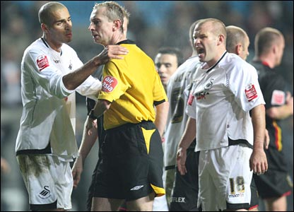 Darren Pratley and Andy Robinson berate the referee after Swansea are denied a late equaliser against Huddersfield