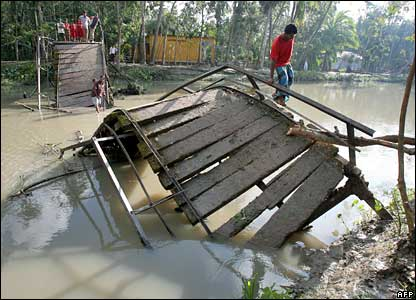 Villagers cross a bridge near Pirojpur, Bangladesh, 17 November 2007
