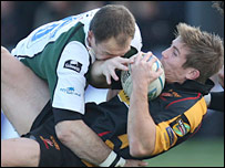 London Irish fly-half Mike Catt tackles Dragons wing Richard Mustoe
