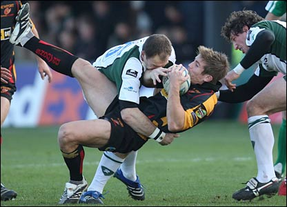 The Exiles turn the screw at Rodney Parade with Mike Catt, tackling Richard Mustoe here, one of four early London Irish try-scorers