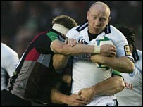Tom Shanklin of the Blues is tackled by Jim Evans of Harlequins
