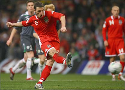 But Jason Koumas rescues a draw for Wales with an 89th-minute penalty after David Cotterill is brought down