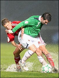 Chris Sorensen of Denmark in action against Northern Ireland's Keith Gillespie