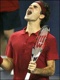 Roger Federer celebrates winning the Masters Cup