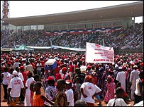 Crowds at the presidential inauguration in the national sports stadium
