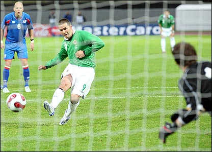 David Healy scores a penalty against Iceland