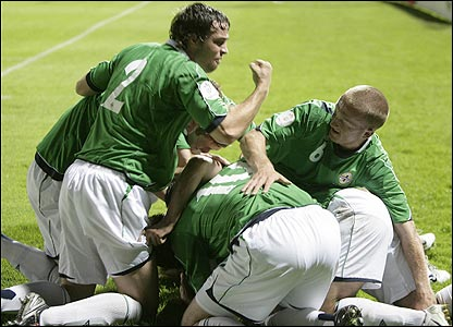 Healy is mobbed after his hat-trick gave Northern Ireland a 3-2 win over Spain in Belfast
