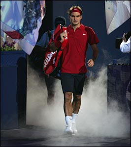 Roger Federer wanders out to court from the changing rooms