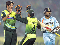 Sohail Tanvir (left) celebrates the key wicket of Sachin Tendulkar