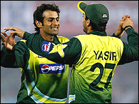 Shoaib Malik (left) starred with bat and ball to fire Pakistan to victory