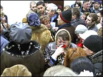 Relatives of Zasyadko miners listen to victims' names being read out by an official at the scene on Sunday