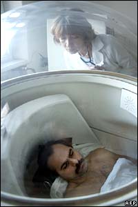 A rescued miner lies inside a pressure chamber in hospital in Donetsk, 18 November