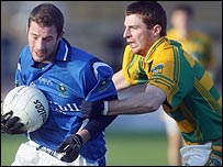 Kieran McGourty is challenged by Gerard O'Kane