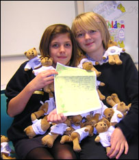 Amie and Bethany, both 12, from Rainham School for Girls in Kent with the school mascots they are sending to rescued street children in India