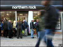 People walking past a branch of Northern Rock bank