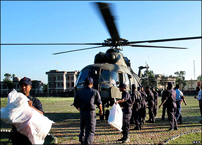 Bangladesh Navy personnel unload aid from a helicopter in Borguna district on the south coast of Bangladesh