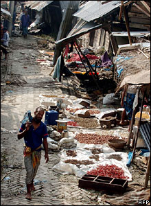 A man walks past a destroyed market at a village in the Rupsha area.