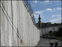 Israel's West Bank barrier in front of a building in Abu Dis intended as a future Palestinian parliament
