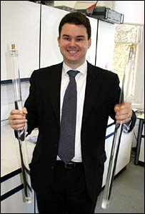 Dr Constantin Coussios holding tubes filled with water to demonstrate the principle of cavitation. Image: Paul Rincon/BBC