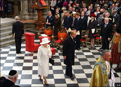 The Queen and Prince Philip walk up the aisle