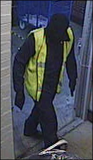 "The masked robber, wearing his ""high visibility"" jacket"
