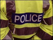 Policeman in hi-vis jacket, BBC